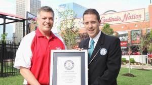 Guinness World Records adjudicator Philip Robertson presents Nathan's Famous representative Chris Madigan with Official World Records Title Certificate